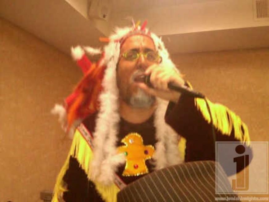 Lipa Schmeltzer singing in the Oholei Torah Ballroom in Crown Heights, Purim night