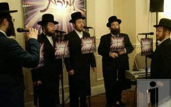Shloime Taussig singing with the Zemiros Choir