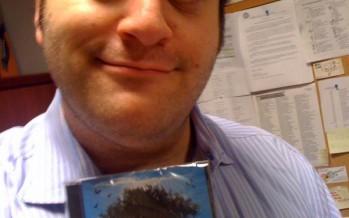 Mike Boxer holding a copy of Six13′s latest album ZMANIM